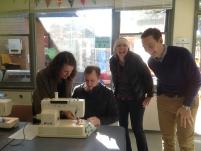 Councillor Stuart picks up a few sewing pointers