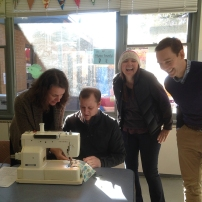 Councillor Stuart picks up a few sewing pointers