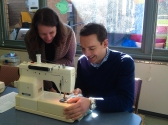 Joanna (Sewing Tutor) giving Parliament Member Steve a few sewing tips