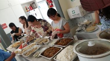 Maggie (cook) & team preparing to serve